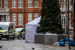 © Licensed to London News Pictures. 06/12/2019. London, UK. A tent stands at the entrance to Hans Crescent next to Harrods after the body of what is believed to be a man in his 20s found with stab wounds outside Harrods Department Store in knightsbridge around 1am this morning. Photo credit: Alex Lentati/LNP