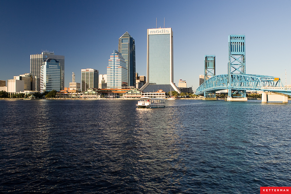 The river taxi shuttles people across the St. John's River in downtown Jacksonville, Florida in the late afternoon on a beautiful day.