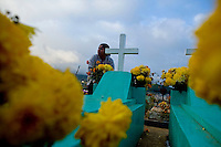 Locals participate in Day Of The Dead celebrations in the cemetery in Santiago De Sacatepequez Thursday Nov. 1, 2007 in Guatemala. ( Photo/Darren  Hauck)..........