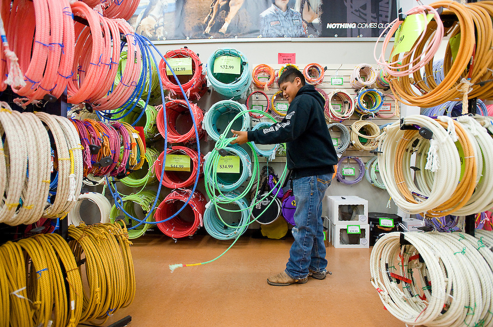 112312       Brian Leddy.Hadley Yazzie of Coyote Canyon tries out the ropes at T&R Rope and Feed Friday morning. The store was one of the only locally owned business to open it's doors for Black Friday.