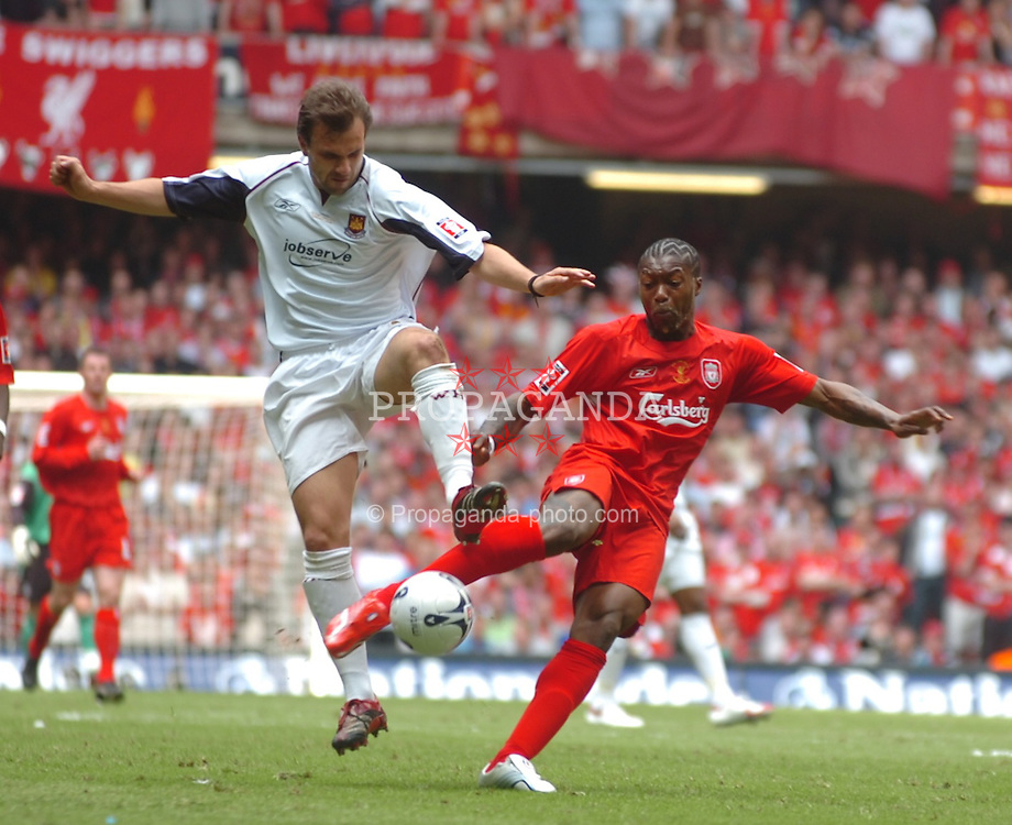 CARDIFF, WALES - SATURDAY, MAY 13th, 2006: Liverpool's Djibril Cisse and West Ham United's Carl Fletcher during the FA Cup Final at the Millennium Stadium. (Pic by Jason Roberts/Propaganda)
