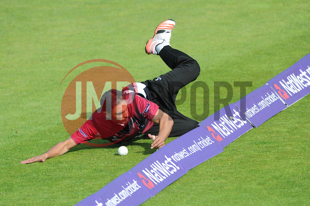 Abdur Rehman of Somerset prevents the ball going over for a 4 - Photo mandatory by-line: Dougie Allward/JMP - Mobile: 07966 386802 - 19/06/2015 - SPORT - Cricket - Bristol - County Ground - Gloucestershire v Somerset - Natwest T20 Blast