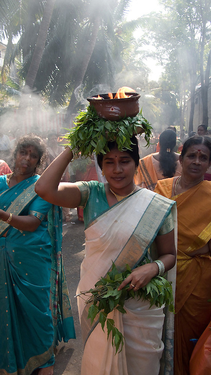 Festival at the Ramanathan Kovil in Kochchikade, Colombo. The Vel cart is taken round the temple, led by a group of women who carry clay pots. The pots carry burning camphor and are held with kohomba (margosa)[Azadirachta indica] leaves.