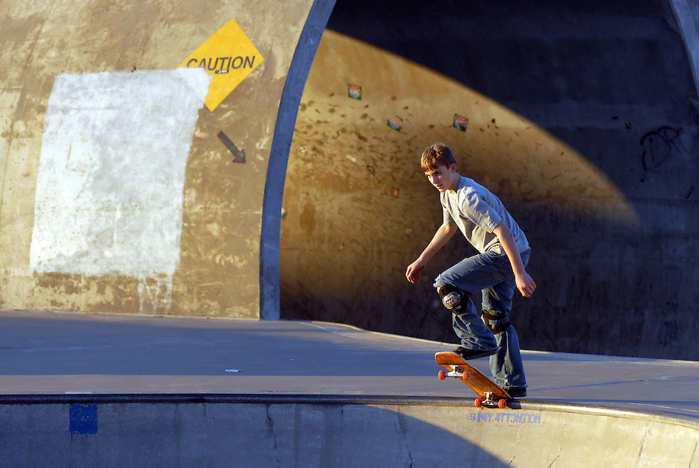 Poised on the edge of the bowl, Aaron Gill, 13, of Louisville, at Waterfront Skate Park, Sunday, Nov. 26, 2006 in Louisville, Ky. (Photo by Brian Bohannon).