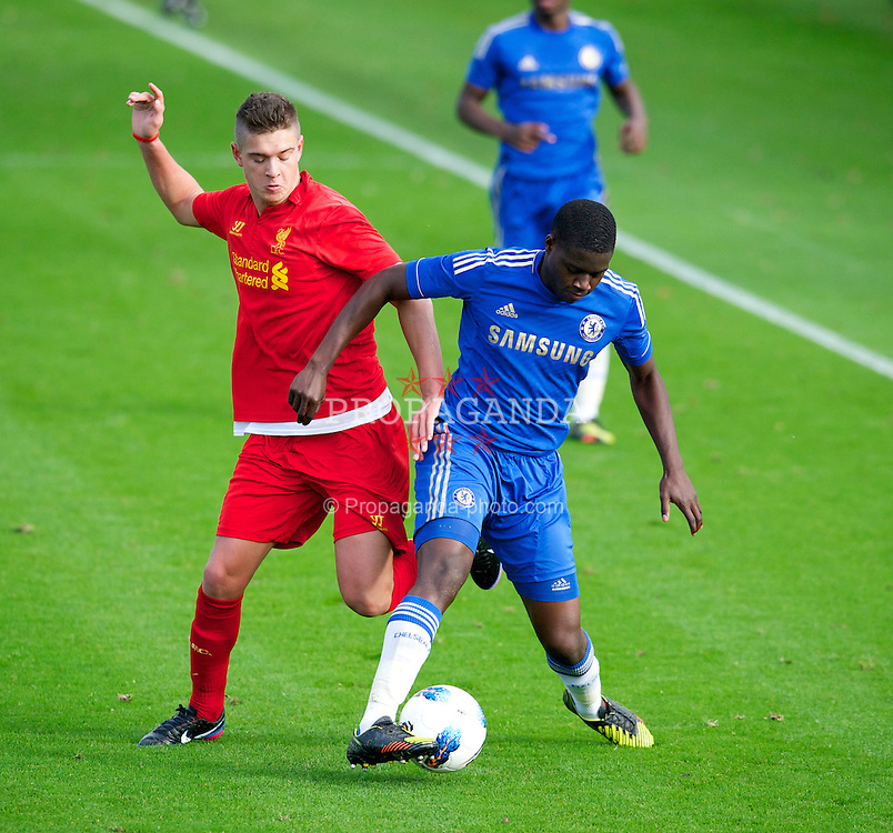 KIRKBY, ENGLAND - Saturday, November 17, 2012: Liverpool's Kristoffer Peterson in action against Chelsea's Issak Ssewentambo during the Premier League Academy match at the Kirkby Academy. (Pic by David Rawcliffe/Propaganda)
