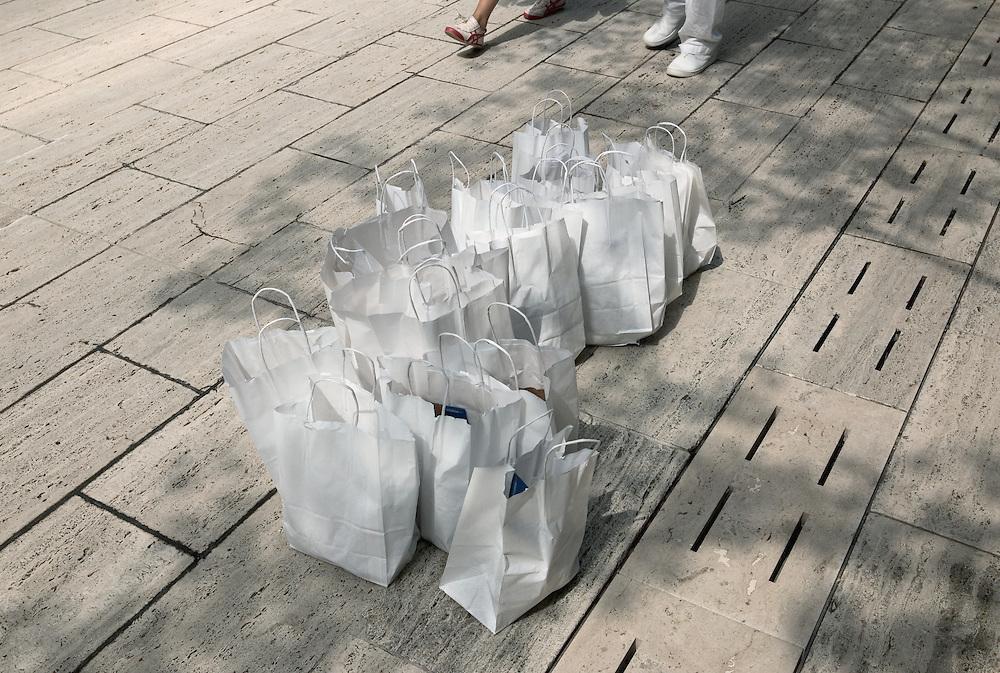 White shopping bags on sidewalk