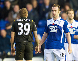 BIRMINGHAM, ENGLAND - Sunday, November 1, 2009: Manchester City's Wales striker Craig Bellamy clashes with Birmingham City's Scotland international James McFadden during the Premiership match at St Andrews. Wales play Scotland in Cardiff in two weeks time. (Pic by David Rawcliffe/Propaganda)