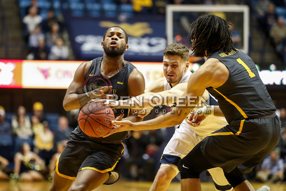 Dec 20, 2017; Morgantown, WV, USA; Coppin State Eagles forward Chad Andrews-Fulton (1) hands the ball off to Coppin State Eagles guard Karonn Davis (10) while West Virginia Mountaineers guard Chase Harler (14) tries to steal during the first quarter at WVU Coliseum. Mandatory Credit: Ben Queen-USA TODAY Sports