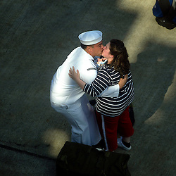 A sailor is greeted after disembarking from the Lincoln on the Navy pier in Everett.