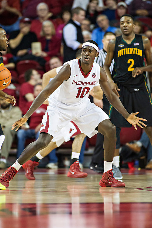 FAYETTEVILLE, AR - DECEMBER 3: Bobby Portis #10 of the Arkansas Razorbacks plays defense against the SE Louisiana Lions at Bud Walton Arena on December 3, 2013 in Fayetteville, Arkansas.  The Razorbacks defeated the Lions 111-65.  (Photo by Wesley Hitt/Getty Images) *** Local Caption *** Bobby Portis