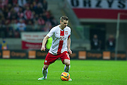 Poland's Lukasz Piszczek controls the ball during international friendly soccer match between Poland and Scotland at National Stadium in Warsaw on March 5, 2014.<br /> <br /> Poland, Warsaw, March 5, 2014<br /> <br /> Picture also available in RAW (NEF) or TIFF format on special request.<br /> <br /> For editorial use only. Any commercial or promotional use requires permission.<br /> <br /> Mandatory credit:<br /> Photo by &copy; Adam Nurkiewicz / Mediasport