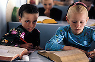 = Mexican menonites, Children at school. The Bible written in gothic German is the only book for studies. No mathematics, no Spanish nothing else than the wholly book.  Ciudad Ghautemoc  Mexico    +