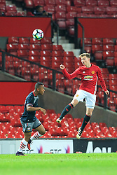 © Licensed to London News Pictures . 12/12/2016 . Manchester , UK . MUFC's GEORGE TANNER wins the ball in the air . Manchester United vs Southampton FA Youth Cup Third Round match at Old Trafford . Photo credit : Joel Goodman/LNP