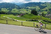 A local riding a Swiss National Bike Route trail near stage 6's starting point in Tobel.