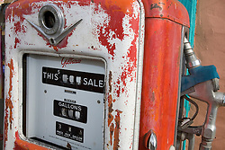 An old style gas pump sits outside a store front in Madrid, NM.<br />