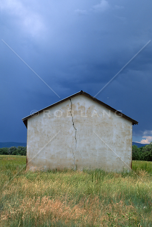 Side of an abandoned house in the middle of a field in New Mexico