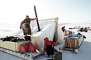 Two patrols of Canadian Rangers riding snowmobiles set up camp on Cornwallis Island, Nunavut during Nunalivut 2012 sovereignty exercise by Canadian Forces in arctic Canada. 24 April 2012.