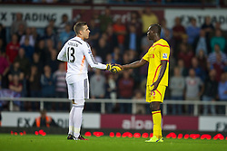LONDON, ENGLAND - Saturday, September 20, 2014: Liverpool's Mario Balotelli and West Ham United's goalkeeper Adrian during the Premier League match at Upton Park. (Pic by David Rawcliffe/Propaganda)