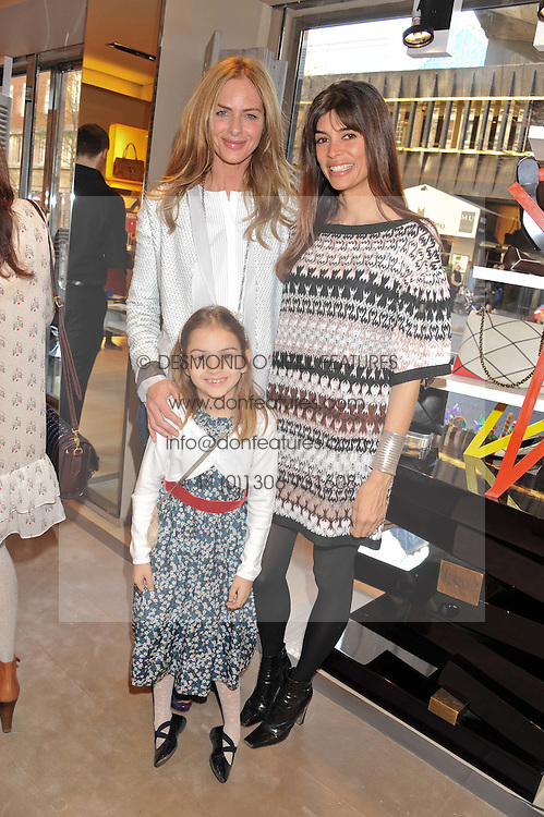 Left to right, TRINNY WOODALL, her daughter LYLA and LISA BILTON at a fun filled tea party hosted by Roger Vivier to view their Jeune Fille collection of shoes in aid of Mothers4Children held at Roger Vivier, Sloane Street, London on 27th March 2012.