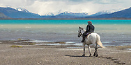 A gaucho looks out over Lago Argentino, in southern Patagonia.