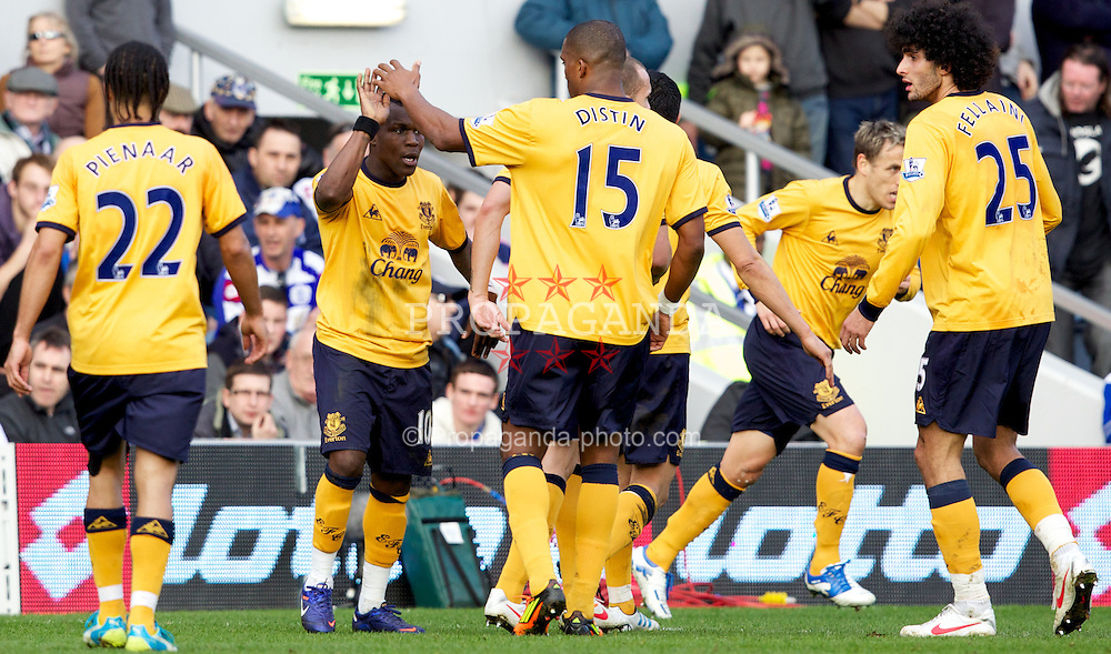 LONDON, ENGLAND - Saturday, March 3, 2012: Everton's celebrates scoring the first goal against Queens Park Rangers with team-mate Sylvain Distin during the Premiership match at Loftus Road. (Pic by Vegard Grott/Propaganda)