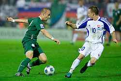 Miso Brecko  of Slovenia vs Miroslav Stoch at  the 2010 FIFA World Cup South Africa Qualifying match between Slovakia and Slovenia, on October 10, 2009, Tehelne Pole Stadium, Bratislava, Slovakia. Slovenia won 2:0. (Photo by Vid Ponikvar / Sportida)