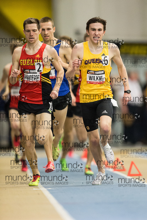 Windsor, Ontario ---2015-03-14--- Alex Wilkie of Queen's University battles with Ross Proudfoot of Guelph in the 1500m at the 2015 CIS Track and Field Championships in Windsor, Ontario, March 14, 2015.<br /> GEOFF ROBINS/ Mundo Sport Images