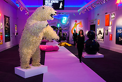 "London, March 4th 2015. Sotheby's in London hosts ""one of the most extraordinary collections of our time"", an anonymous collector's vast assembly of fine art pieces, including skulls, bear sculptures, paintings and installations. PICTURED: Sotheby's main gallery presents a surreal picture dominated by Paola Pivi's lifesize feathered polar bear sculpture, Life Is Great."