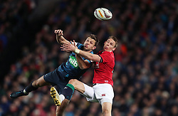 British and Irish Lions' Liam Williams tackles Blues' Matt Duffie in the air, resulting in a sin bin, during the tour match at Eden Park, Auckland.