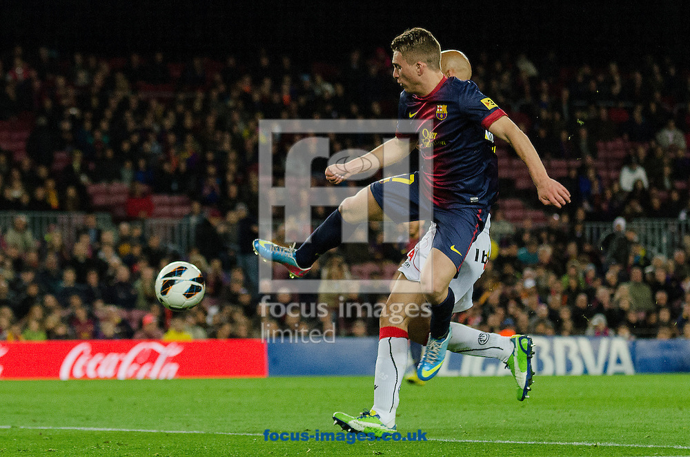 Picture by Cristian Trujillo/Focus Images Ltd +34 64958 5571.06/04/2013.Gerard Deuloufeu of FC Barcelona and Nunes of Real Club Deportivo Mallorca during the La Liga match at Camp Nou, Barcelona.