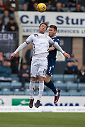 14th September 2019; Dens Park, Dundee, Scotland; Scottish Championship, Dundee Football Club versus Alloa Athletic; Robert Thomson of Alloa Athletic competes in the air with Jordan McGhee of Dundee