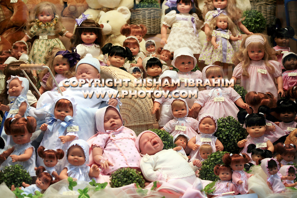 Collection of baby dolls on display in a gift shop - Madrid, Spain