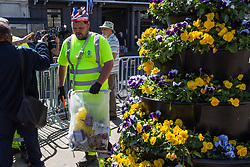 A council worker wears a paper crown as he cleans up the streets as excitement mounts in Windsor ahead of the royal wedding on Saturday 19th May when HRH Prince Harry weds actress Megan Markle. Windsor, May 17 2018.