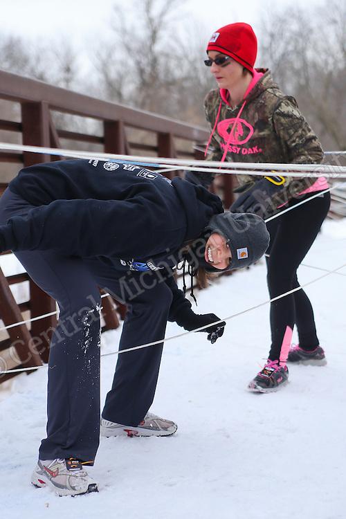 Man vs Mountain is a unique winter 5K obstacle course in Mt Pleasant, MI, that challenges participants to brave Michigan's brutal elements!
