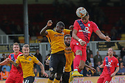 York City forward Vadaine Oliver wins a header during the Sky Bet League 2 match between Newport County and York City at Rodney Parade, Newport, Wales on 5 September 2015. Photo by Simon Davies.