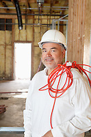 Portrait of a construction worker with a red electric wire