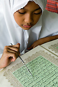 Schoolgirl reading the Koran in class, Bandar Seri Begawan