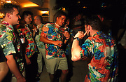Group of drunk men wearing Hawaiian shirts at a bar Ibiza 1990's