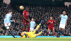 Manchester City's John Stones (left) hits the ball against goalkeeper Ederson (floor) before clearing the ball off the line during the Premier League match at the Etihad Stadium, Manchester.