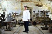 Du Jianlin, Chef to the Great Hall of the People in Beijing China, poses for a portrait in the Cascina Colombara during the annual meeting of the Club des Chefs des Chefs in Livorno Ferraris, Vercelli, Italy, July 18, 2015.<br /> The Club des Chefs des Chefs, which is seen as the world's most exclusive gastronomic society, has extremely strict membership criteria: to be accepted into this highly elite club, you need to be the current personal chef of a head of state. If he or she does not have a personal chef, members can be the executive chef of the venue that hosts official State receptions. One of the society's primary purposes is to promote major culinary traditions and to protect the origins of each national cuisine. The Club des Chefs des Chefs also aims to develop friendship and cooperation between its members, who have similar responsibilities in their respective countries. <br /> The annual meeting of the Club has been hosted this year in the production site of the Italian rice company called Riso Acquerello. <br /> © Giorgio Perottino