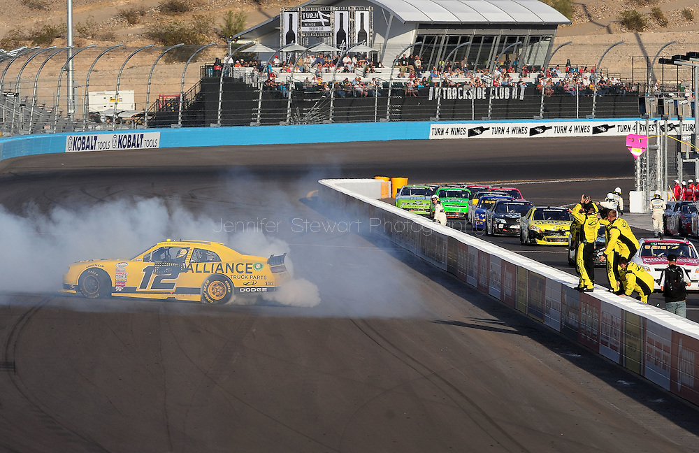 Nov. 12 2011; Avondale, AZ, USA; NASCAR Nationwide Series driver Sam Hornish Jr. does a burnout after winning the Wypall 200 at Phoenix International Raceway. Mandatory Credit: Jennifer Stewart-US PRESSWIRE