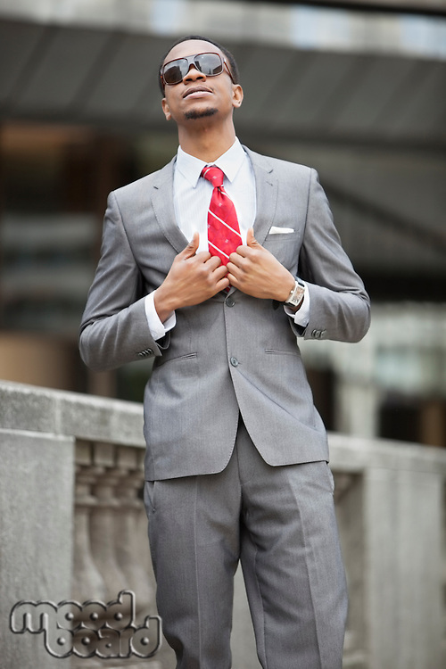 Smart African American young businessman wearing sunglasses