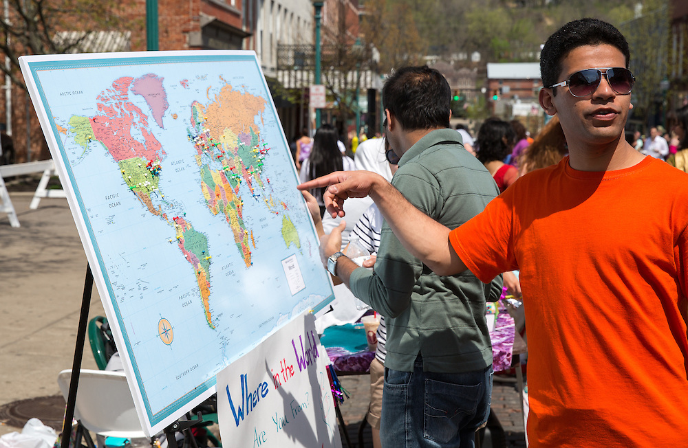Raco Mandez looks at a map of pins showcasing where attendees of the International Street Fair are from.