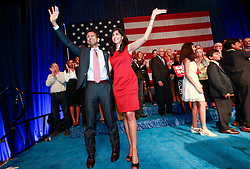 24 June 2015. Kenner, Louisiana.<br /> Louisiana Governor Bobby Jindal and wife Supriya celebrate after Jindal announces his run for President of the United States during a political event at the Pontchartrain Center in Kenner, La.<br /> Photo©; Charlie Varley/varleypix.com