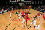 February 13, 2014: Alicia DeVaughn #13 of Maryland shoots past Suriya McGuire #33 and Adrienne Motley #23 of Miami during the NCAA basketball game between the Miami Hurricanes and the Maryland Terrapins at the Bank United Center in Coral Gables, FL. The Terrapins defeated the Hurricanes 67-52.