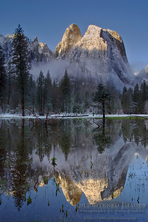 Morning light and clearing spring storm clouds on Cathedral Rock, Yosemite Valley, Yosemite National Park, California