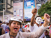 "09 JUNE 2013 - BANGKOK, THAILAND: Members of the White Mask protest movement gather on the plaza in front of Central World in Bangkok. The White Mask protesters wear the Guy Fawkes mask popularized by the movie ""V for Vendetta"" and the protest groups Anonymous and Occupy. Several hundred members of the White Mask movement gathered on the plaza in front of Central World, a large shopping complex at the Ratchaprasong Intersection in Bangkok, to protest against the government of Thai Prime Minister Yingluck Shinawatra. They say that her government is corrupt and is a ""puppet"" of ousted (and exiled) former PM Thaksin Shinawatra. Thaksin is Yingluck's brother. She was elected in 2011 when her brother endorsed her.     PHOTO BY JACK KURTZ"