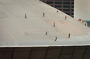 Worker repair  the roof of the Superdome almost a year after Hurricane Katrina damaged the building.