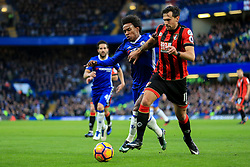 Charlie Daniels of Bournemouth holds back Willian of Chelsea - Mandatory by-line: Jason Brown/JMP - 26/12/2016 - FOOTBALL - Stamford Bridge - London, England - Chelsea v Bournemouth - Premier League