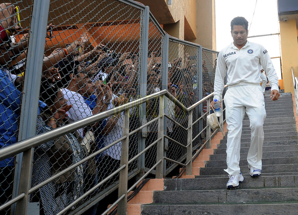 Sachin Tendulkar of India walks down to take the field during day three of the second Star Sports test match between India and The West Indies held at The Wankhede Stadium in Mumbai, India on the 16th November 2013<br /> <br /> This test match is the 200th test match for Sachin Tendulkar and his last for India.  After a career spanning more than 24yrs Sachin is retiring from cricket and this test match is his last appearance on the field of play.<br /> <br /> <br /> Photo by: Pal Pillai - BCCI - SPORTZPICS<br /> <br /> Use of this image is subject to the terms and conditions as outlined by the BCCI. These terms can be found by following this link:<br /> <br /> http://sportzpics.photoshelter.com/gallery/BCCI-Image-Terms/G0000ahUVIIEBQ84/C0000whs75.ajndY